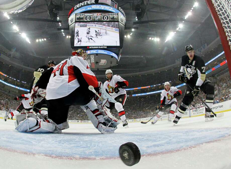 Senators goalie Craig Anderson watches Paul Martin's shot fly past for the first of four Penguins goals Tuesday night. Photo: Justin K. Aller, Stringer / 2013 Getty Images
