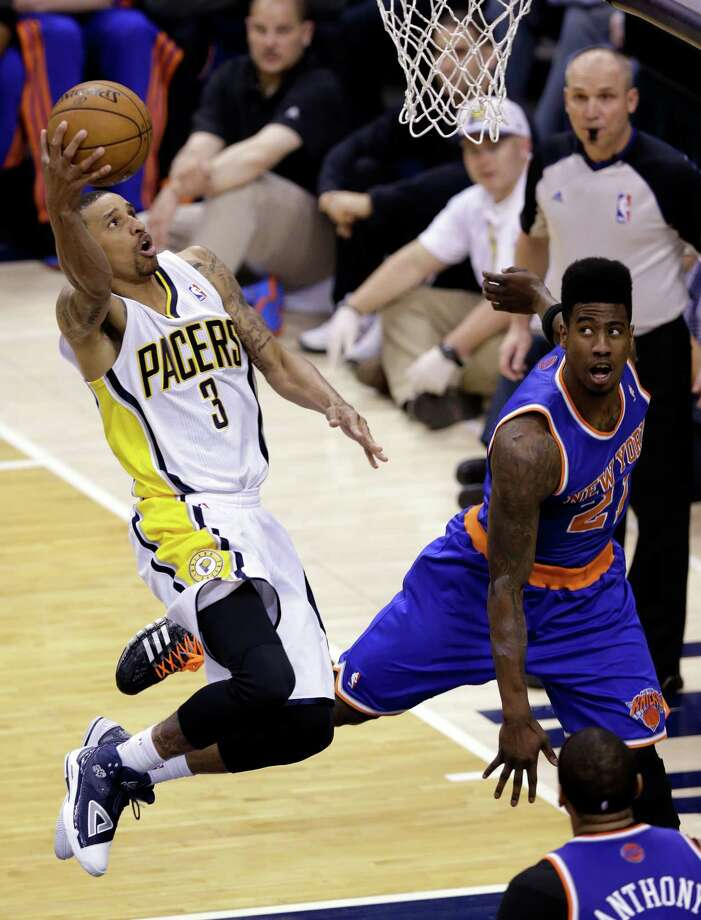 Indiana Pacers guard George Hill, left, hits a shot over New York Knicks forward Iman Shumpert during the second half of Game 4 of the Eastern Conference semifinal NBA basketball playoff series, in Indianapolis on Tuesday, May 14, 2013. (AP Photo/Michael Conroy) Photo: Michael Conroy