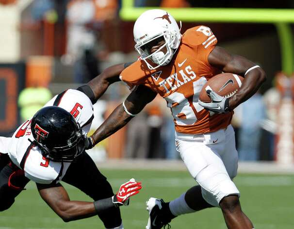 Texas' Marquise Goodwin (84) and Texas Tech's Shawn Corker (9) during the third fourth quarter of an NCAA college football game, Saturday, Nov. 5, 2011, in Austin, Texas. (AP Photo/Eric Gay) Photo: Associated Press / AP