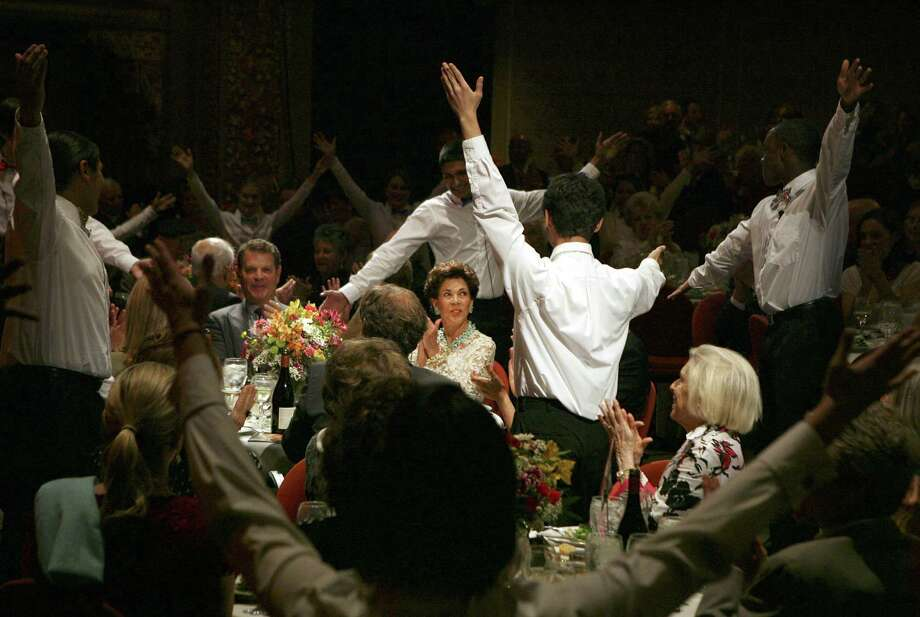 """North East School of the Arts students perform flash mob-style for the gala's guest of honor, Jocelyn """"Joci"""" Straus, at the Charline McCombs Empire Theater. Straus is the founder of the nonprofit Las Casas, which is dedicated to the preservation and development of the Empire and the Majestic Theatre. Photo: Photos By Cynthia Esparza / For The San Antonio Express-News"""