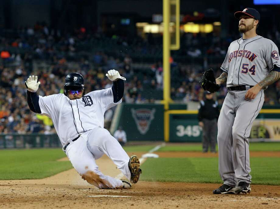 The Tigers' Prince Fielder lumbers home on a wild pitch by reliever Travis Blackley, right, who came on when Astros starter Lucas Harrell could not retire a batter in the sixth inning Wednesday night. Photo: Duane Burleson, Stringer / 2013 Getty Images