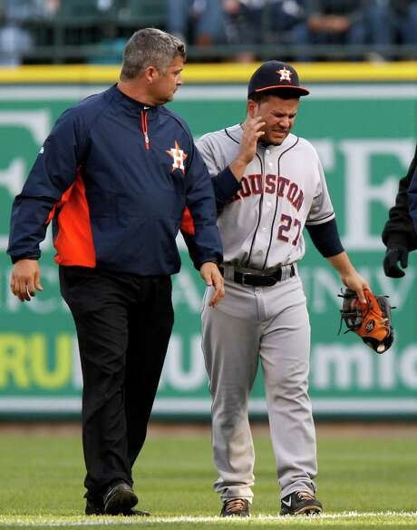 The joy with which Jose Altuve normally plays the game temporarily has been replaced by physical and emotional pain resulting from a dislocated jaw injury, right, suffered in a collision Monday and the death of  his grandmother, which will keep the second baseman away from the team until Saturday. Photo: Duane Burleson, Stringer / 2013 Getty Images