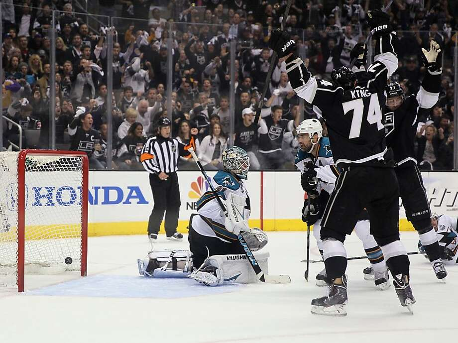 Dwight King celebrates a goal by Slava Voynov that beat Sharks goaltender Antti Niemi (center) to make it 1-0. Photo: Jeff Gross, Getty Images
