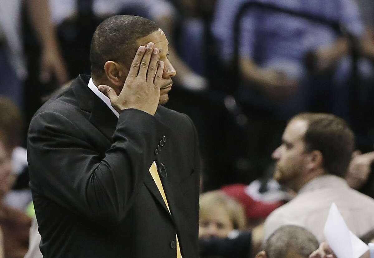 Golden State Warriors' head coach Mark Jackson pauses on the sideline against the San Antonio Spurs during the second half in Game 5 of a Western Conference semifinal NBA basketball playoff series, Tuesday, May 14, 2013, in San Antonio. (AP Photo/Eric Gay)