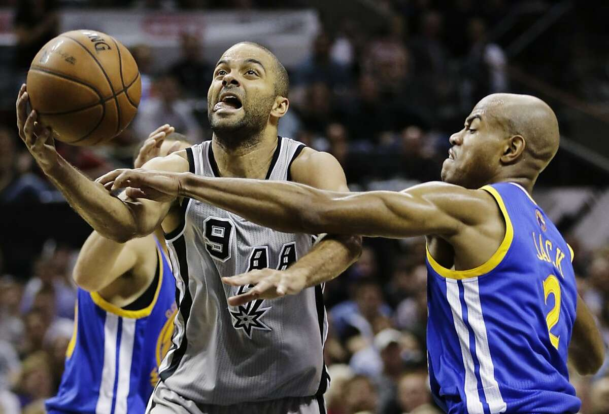 San Antonio Spurs' Tony Parker (9), of France, is fouled byGolden State Warriors' Jarrett Jack, right, during the first half in Game 5 of a Western Conference semifinal NBA basketball playoff series, Tuesday, May 14, 2013, in San Antonio. (AP Photo/Eric Gay)