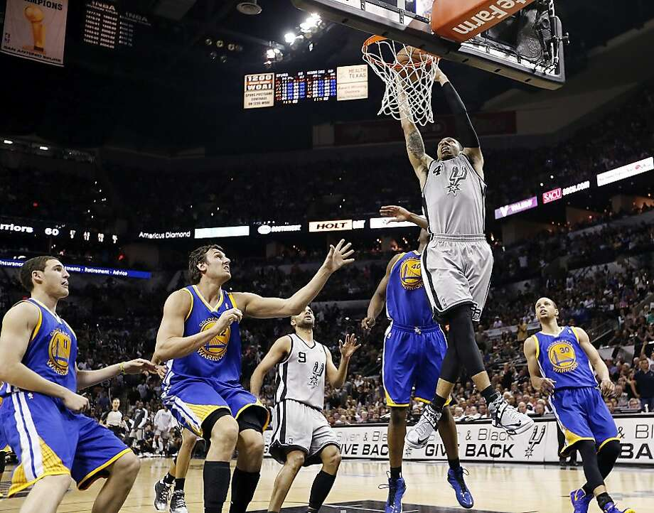 San Antonio Spurs' Danny Green goes up for a dunk over Golden State Warriors' Klay Thompson (from left), Golden State Warriors' Andrew Bogut, Golden State Warriors' Harrison Barnes and Golden State Warriors' Stephen Curry during second half action of Game 5 in the NBA Western Conference semifinals Tuesday May 14, 2013 at the AT&T Center. The Spurs won 109-91. Photo: Edward A. Ornelas, San Antonio Express-News