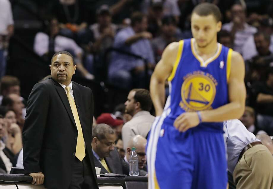 Golden State Warriors' head coach Mark Jackson and Stephen Curry (30) pause between plays against the San Antonio Spurs during the second half in Game 5 of a Western Conference semifinal NBA basketball playoff series, Tuesday, May 14, 2013, in San Antonio. (AP Photo/Eric Gay) Photo: Eric Gay, Associated Press