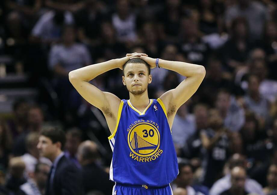 Golden State Warriors' Stephen Curry pauses during time out against the San Antonio Spurs during the first half in Game 5 of a Western Conference semifinal NBA basketball playoff series, Tuesday, May 14, 2013, in San Antonio. (AP Photo/Eric Gay) Photo: Eric Gay, Associated Press