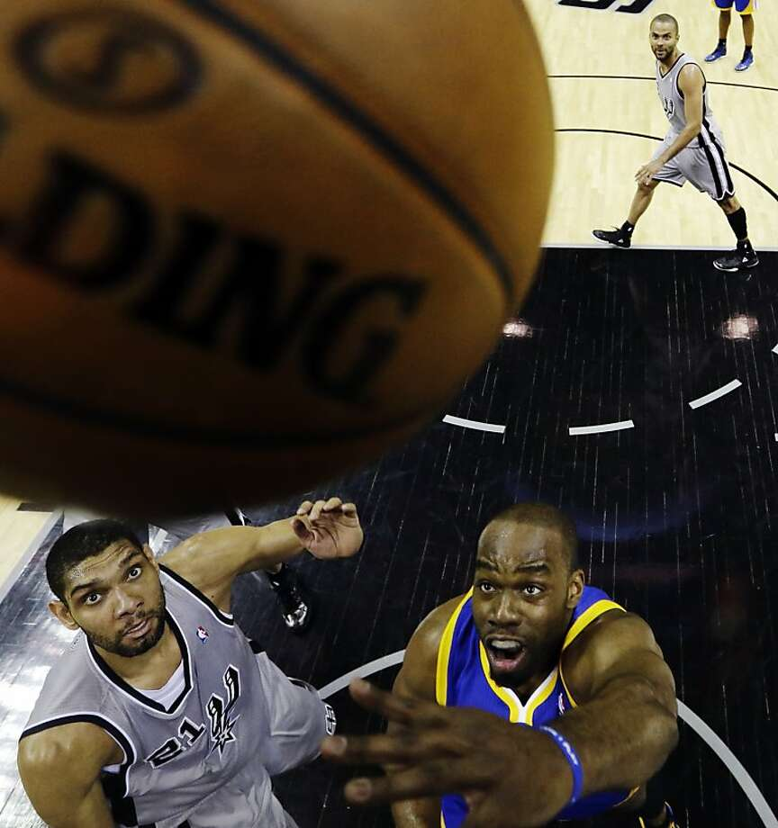 Golden State Warriors' Carl Landry, right, shoots over San Antonio Spurs' Tim Duncan, left, during the first half in Game 5 of a Western Conference semifinal NBA basketball playoff series, Tuesday, May 14, 2013, in San Antonio. (AP Photo/Eric Gay) Photo: Eric Gay, Associated Press