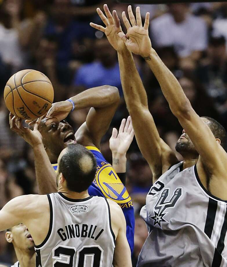 Golden State Warriors' Carl Landry, center, is defended by San Antonio Spurs' Manu Ginobili,left, of Argentina, and San Antonio Spurs' Tim Duncan, right, during the first half in Game 5 of a Western Conference semifinal NBA basketball playoff series, Tuesday, May 14, 2013, in San Antonio. (AP Photo/Eric Gay) Photo: Eric Gay, Associated Press