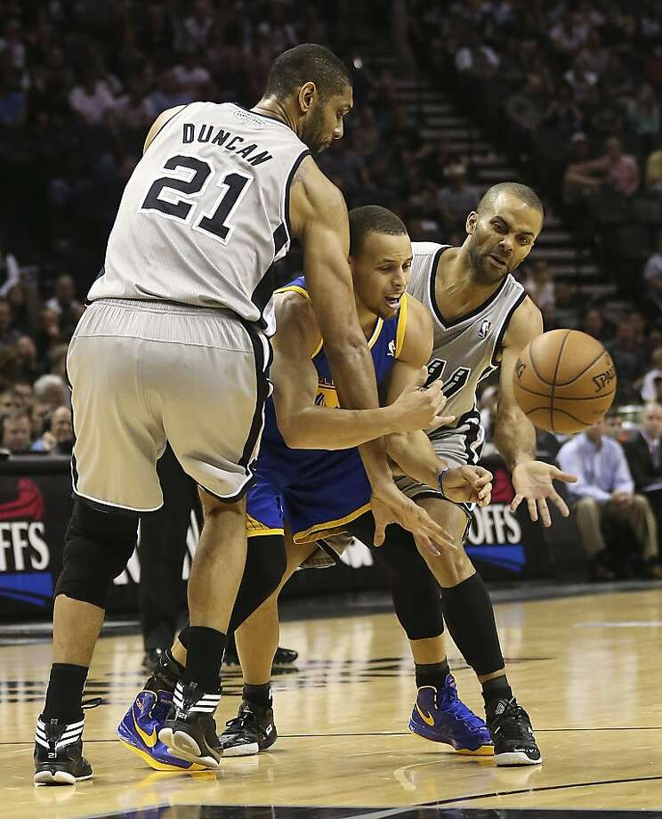 San Antonio Spurs' Tim Duncan and Tony Parker strip the ball from Golden State Warriors' Stephen Curry during the second half of Game 5 in the NBA Western Conference semifinals at the AT&T Center, Tuesday, May 14, 2013. The Spurs won 109-91 and lead the series at 3-2. Photo: Jerry Lara, San Antonio Express-News