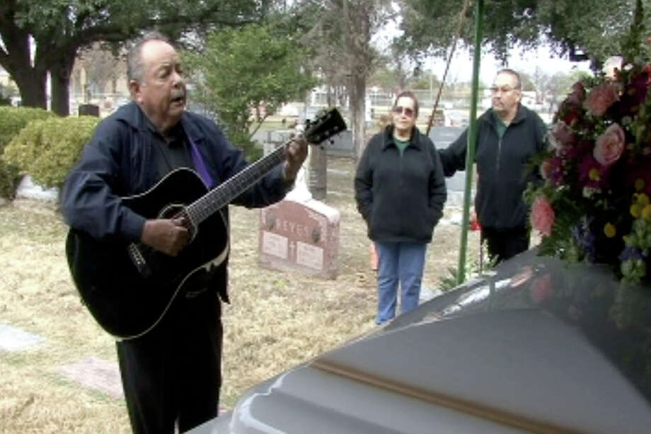 Hector Garza sings before the casket of Tejano music legend Lydia Mendoza at her funeral in San Antonio in 2007. Mendoza was known for her songs of heartbreak, and Hispanic and immigrant culture.  Photo: BILLY CALZADA, SAN ANTONIO EXPRESS-NEWS