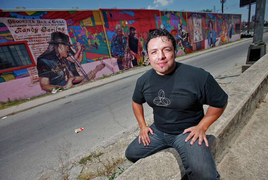 "Local artist David Blancas is working on a nearly 150-feet wide mural called ""La Musica de San Anto"" on the city's West side that depicts some of the city's icons of music. Among the musical artists are: Randy Garibay, Clifford Scott, Rocky Morales, Felix Villarreal, Manny Castillo, Eva Garza, Doug Sahm, Lydia Mendoza and Guadalupe and Aurora Olguin.  Photo: KIN MAN HUI, San Antonio Express-News / kmhui@express-news.net"