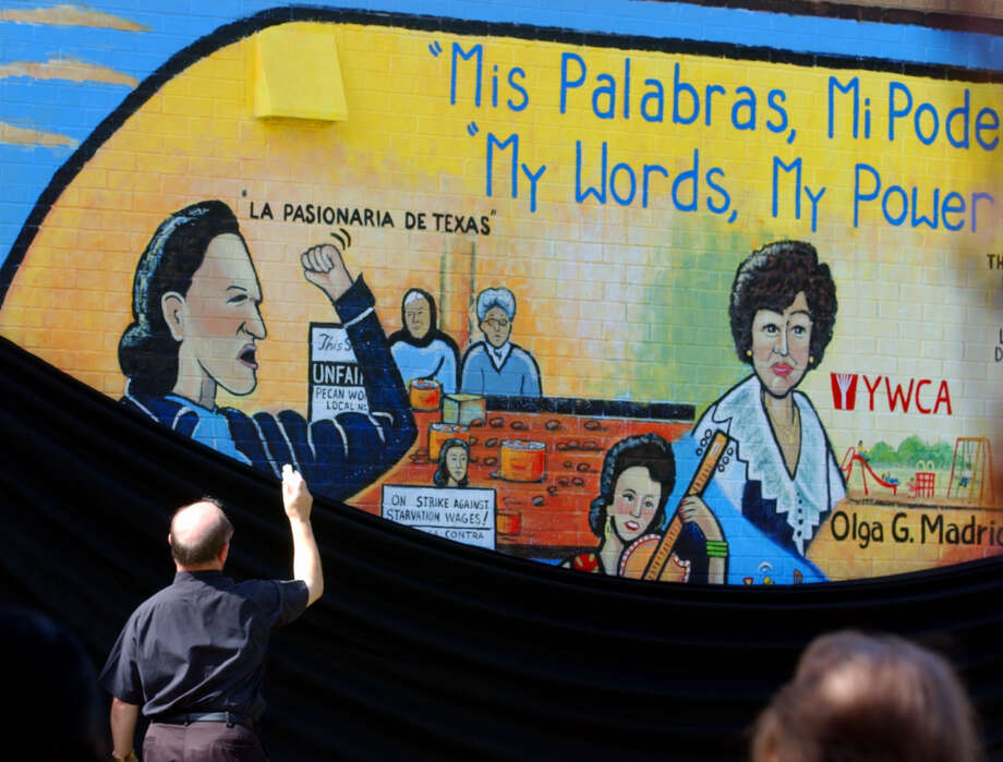"Father Jose Giganto of St. Jude's Parish, blesses a mural at the dedication of the mural ""Mis Palabras Mi Poder,"" in 2002 at Burleson Elementary School. Five women (Isabel Bazan, Margarita Huantes, Olga Madrid, Lydia Mendoza and Emma Tenayuca) are featured on the painted wall.  Photo: BAHRAM MARK SOBHANI, SAN ANTONIO EXPRESS-NEWS / SAN ANTONIO EXPRESS-NEWS"