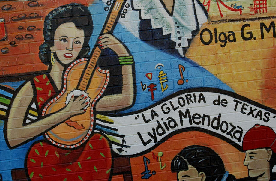 "Lydia Mendoza, a musician, is featured with other women on a mural at Burleson Elementary School. ""Mis Palabras, Mi Poder"" is a mural honoring five women role models from the West side.  Photo: JOSHUA TRUJILLO, SAN ANTONIO EXPRESS-NEWS / SAN ANTONIO EXPRESS-NEWS"