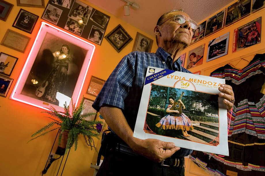 Salome Gutierrez poses in his Tejas Music Museum with some of his Lydia Mendoza memorabilia back in 2006.  Photo: WILLIAM LUTHER, SAN ANTONIO EXPRESS-NEWS / © San Antonio Express-News