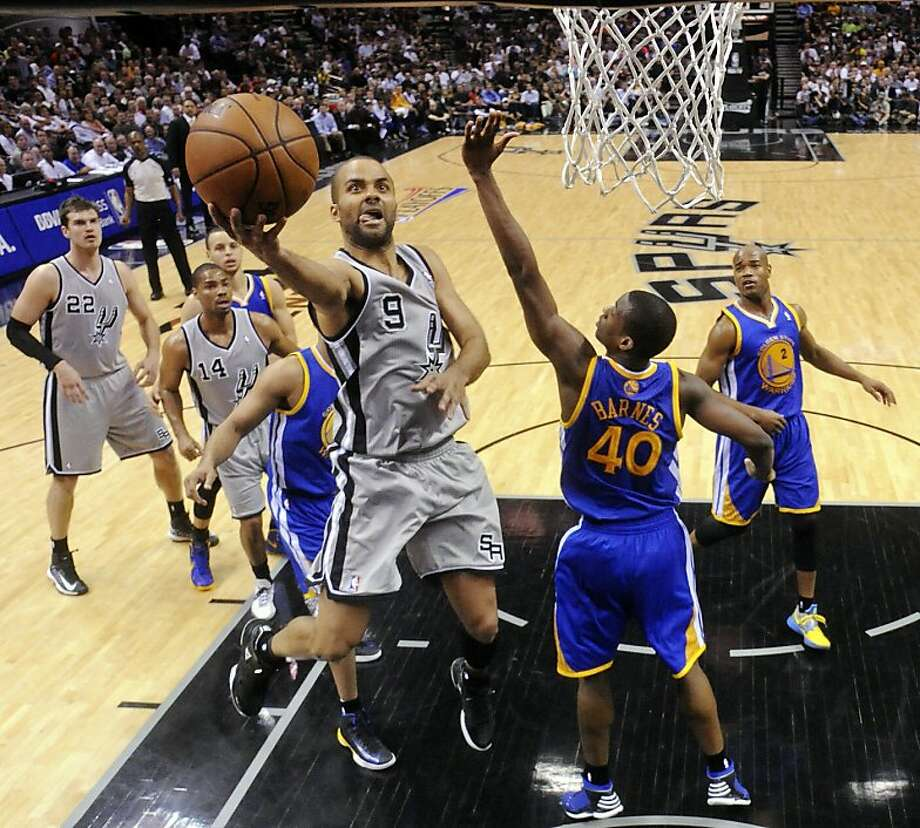 San Antonio Spurs' Tony Parker shoots around Golden State Warriors' Harrison Barnes during first half action of Game 5 in the NBA Western Conference semifinals Tuesday May 14, 2013 at the AT&T Center. Photo: Edward A. Ornelas, San Antonio Express-News