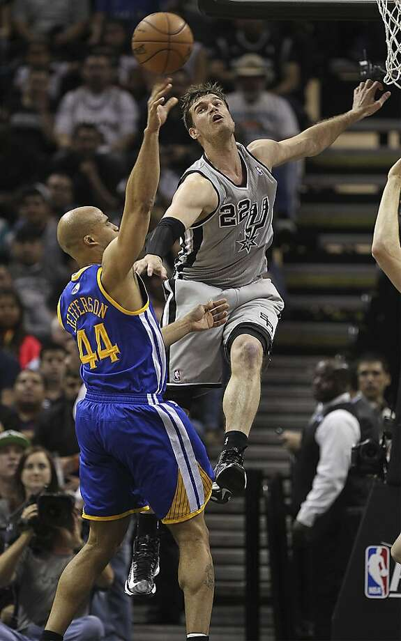 San Antonio Spurs' Tiago Splitter tries to block a shot by Golden State Warriors' Richard Jefferson during the first half of Game 5 in the NBA Western Conference semifinals at the AT&T Center, Tuesday, May 14, 2013. Photo: Jerry Lara, San Antonio Express-News