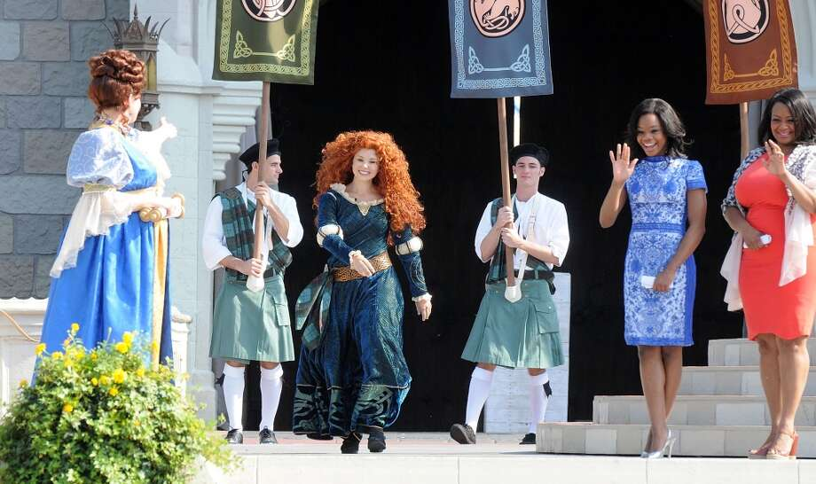 A model portraying Princess Merida enters her 'royal celebration' at the Magic Kingdom at Walt Disney World Resort in conjunction with Mother's Day festivities on May 11, 2013 in Lake Buena Vista, Fla.