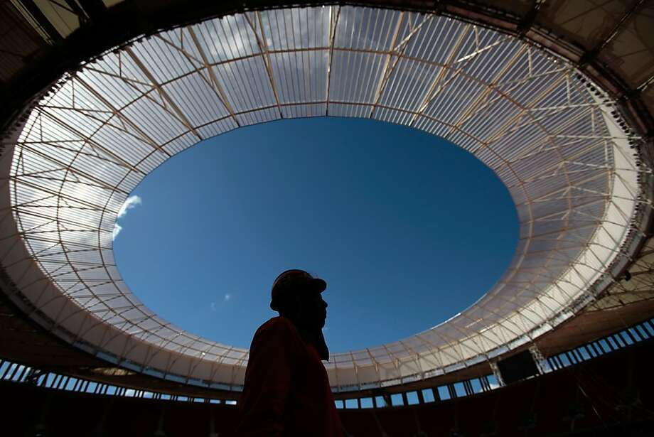 An employee stand inside the National Stadium Mane Garrincha in Brasilia, Brazil, Tuesday, May 14, 2013. The stadium is being remodeled for the upcoming Confederations Cup  in June 2013 and the 2014 World Cup soccer tournament. (AP Photo/Eraldo Peres) Photo: Eraldo Peres, Associated Press