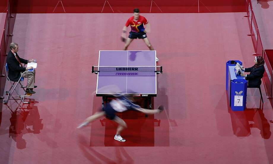 Hunor Szocs of Romania, top returns the ball to Alfredas Udra Of Lithuania during their men's single qualifying match at the World Table Tennis Championships in Paris, Tuesday, May 14, 2013. (AP Photo/Christophe Ena) Photo: Christophe Ena, Associated Press