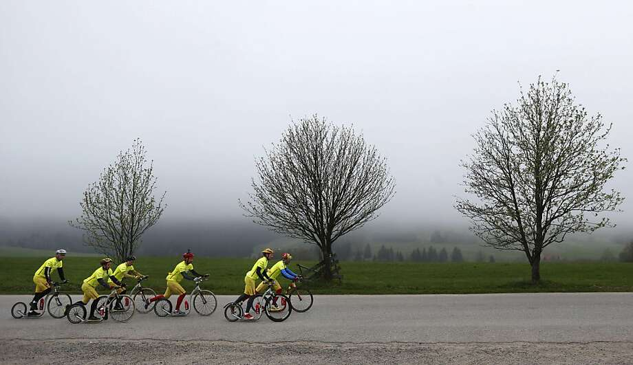 A group of kick bikers train in the Sumava Mountains, Southwest Czech Republic, Monday, May 6, 2013.  An international team of six riders from the Czech Republic, Finland and the Netherlands is set to do what no one has done before: to mark the 100th edition of the Tour de France, they plan to cover the entire distance on kick bikes. (AP Photo/Petr David Josek) Photo: Petr David Josek, Associated Press