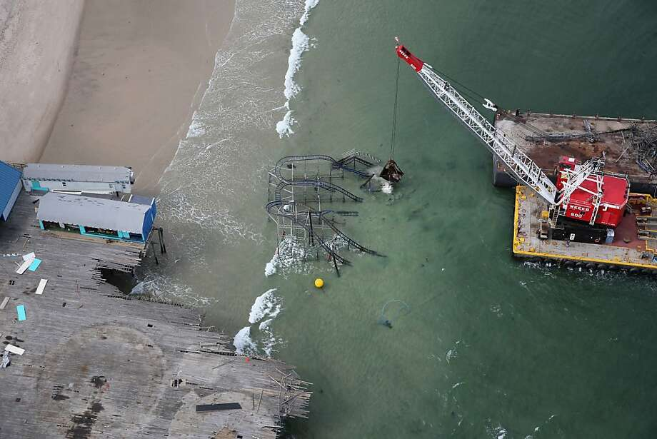 SEASIDE HEIGHTS, NJ - MAY 14:  A crane demolishes the JetStar roller coaster more than 6 months after it fell into the ocean during Superstorm Sandy on May 14, 2013 in Seaside Heights, New Jersey. The Casino Pier contracted Weeks Marine to remove the wreckage of the iconic roller coaster from the surf.  (Photo by John Moore/Getty Images)  *** BESTPIX *** Photo: John Moore, Getty Images
