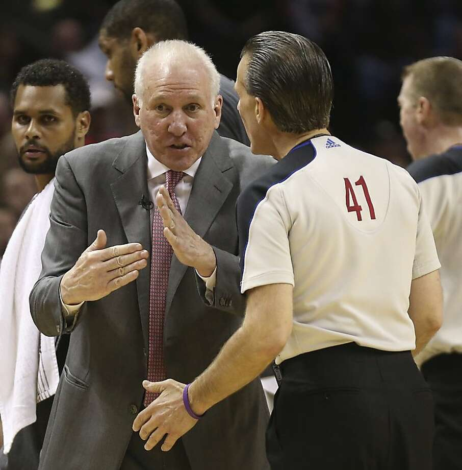 San Antonio Spurs head coach Gregg Popovich talks with official Ken Mauer after calling a time out during the second half of Game 5 in the NBA Western Conference semifinals against the Golden State Warriors  at the AT&T Center, Tuesday, May 14, 2013. The Spurs won 109-91 and lead the series at 3-2. Photo: Jerry Lara, San Antonio Express-News