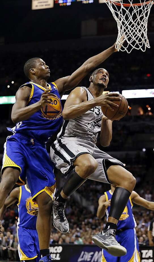 San Antonio Spurs' Boris Diaw shoots around Golden State Warriors' Harrison Barnes during second half action in Game 5 of the NBA Western Conference semifinals Tuesday May 14, 2013 at the AT&T Center. Diaw was fouled on the play. The Spurs won 109-91. Photo: Edward A. Ornelas, San Antonio Express-News