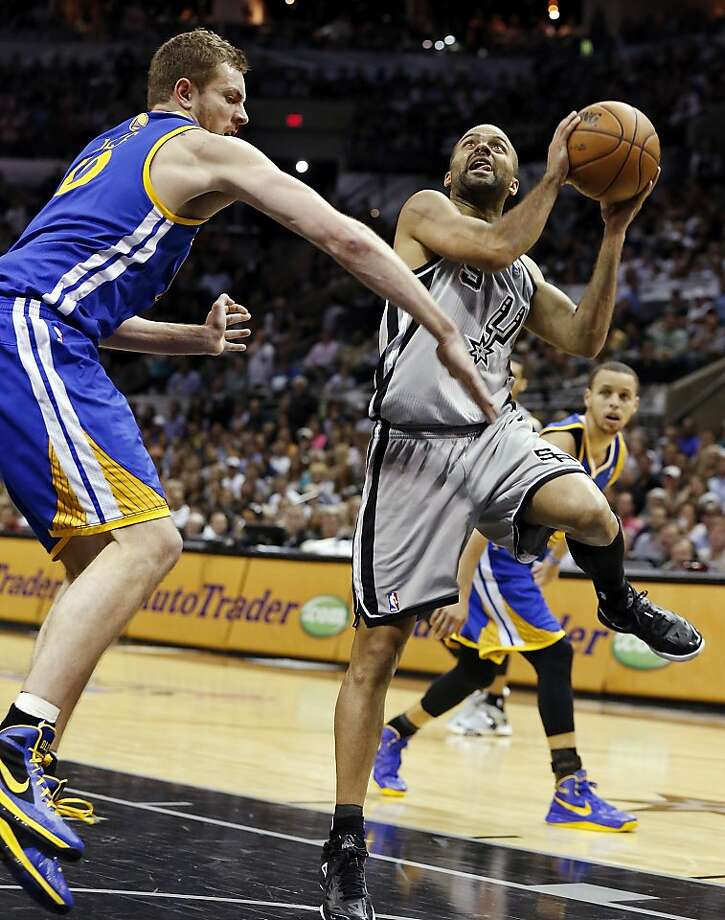 San Antonio Spurs' Tony Parker drives around Golden State Warriors' David Lee during second half action of Game 5 in the NBA Western Conference semifinals Tuesday May 14, 2013 at the AT&T Center. The Spurs won 109-91. Photo: Edward A. Ornelas, San Antonio Express-News