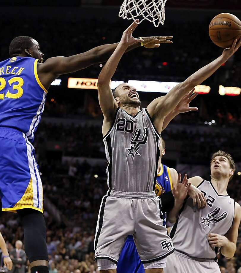 San Antonio Spurs' Manu Ginobili shoots around Golden State Warriors' Draymond Green during second half action of Game 5 in the NBA Western Conference semifinals Tuesday May 14, 2013 at the AT&T Center. The Spurs won 109-91. Photo: Edward A. Ornelas, San Antonio Express-News
