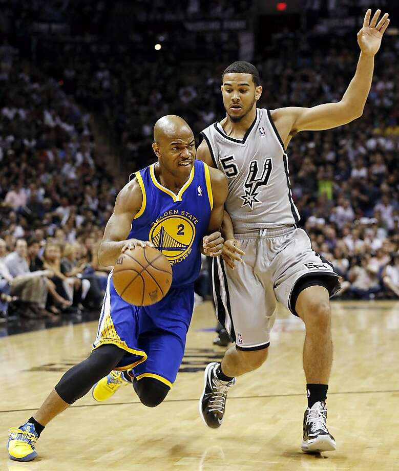 Golden State Warriors' Jarrett Jack drives around San Antonio Spurs' Cory Joseph during first half action of Game 5 in the NBA Western Conference semifinals Tuesday May 14, 2013 at the AT&T Center. Photo: Edward A. Ornelas, San Antonio Express-News