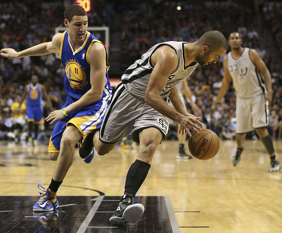 San Antonio Spurs' Tony Parker steals the ball from Golden State Warriors' Klay Thompson during the second half of Game 5 in the NBA Western Conference semifinals at the AT&T Center, Tuesday, May 14, 2013. The Spurs won 109-91 and lead the series at 3-2. Photo: Jerry Lara, San Antonio Express-News
