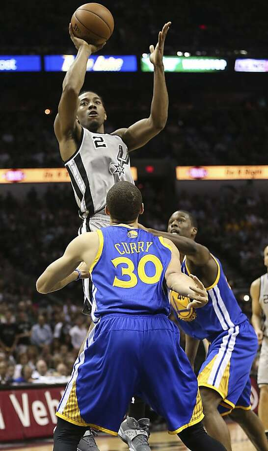 San Antonio Spurs' Kawhi Leonard shoots over Golden State Warriors' Stephen Curry and Harrison Barnes during the first half of Game 5 in the NBA Western Conference semifinals at the AT&T Center, Tuesday, May 14, 2013. Photo: Jerry Lara, San Antonio Express-News