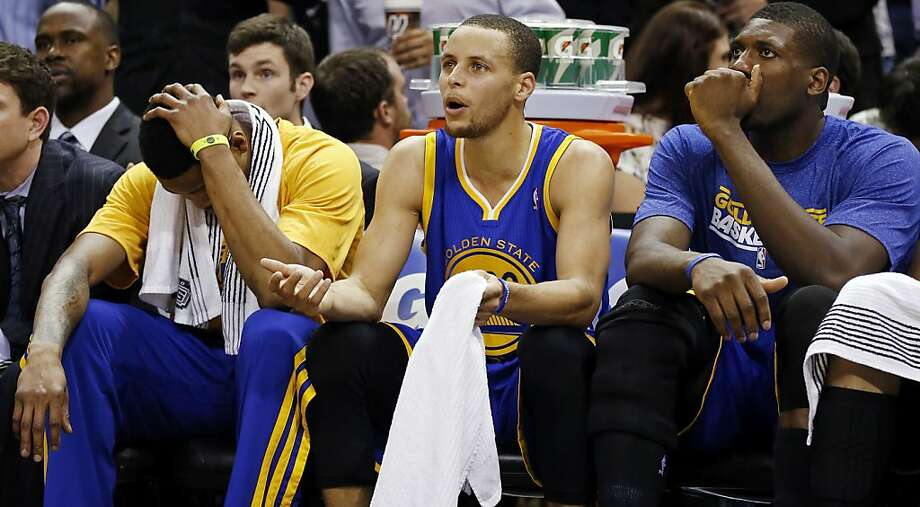 Golden State Warriors' Brandon Rush (from left) Golden State Warriors' Stephen Curry and Golden State Warriors' Kent Bazemore sit on the bench during second half action of Game 5 in the NBA Western Conference semifinals Tuesday May 14, 2013 at the AT&T Center. The Spurs won 109-91. Photo: Edward A. Ornelas, San Antonio Express-News