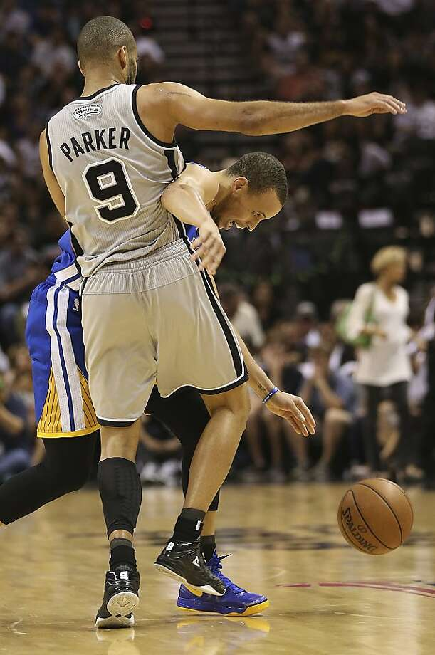San Antonio Spurs' Tony Parker puts pressure on Golden State Warriors' Stephen Curry during the second half of Game 5 in the NBA Western Conference semifinals at the AT&T Center, Tuesday, May 14, 2013. The Spurs won 109-91 and lead the series at 3-2. Photo: Jerry Lara, San Antonio Express-News