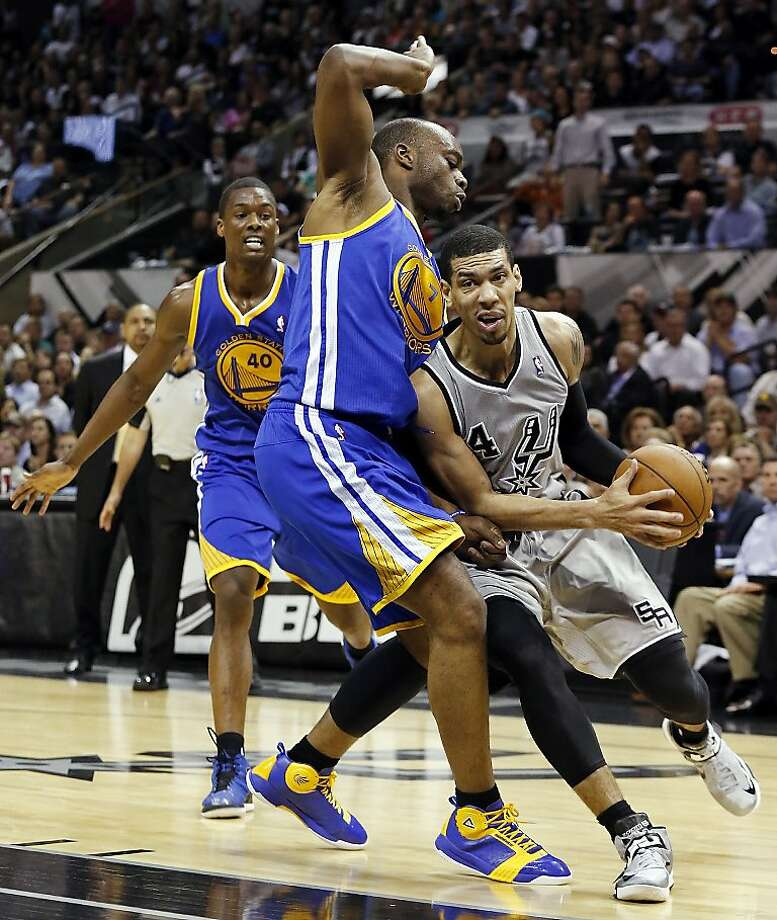 San Antonio Spurs' Danny Green looks for room around Golden State Warriors' Carl Landry as Golden State Warriors' Harrison Barnes looks on during second half action of Game 5 in the NBA Western Conference semifinals Tuesday May 14, 2013 at the AT&T Center. The Spurs won 109-91. Photo: Edward A. Ornelas, San Antonio Express-News
