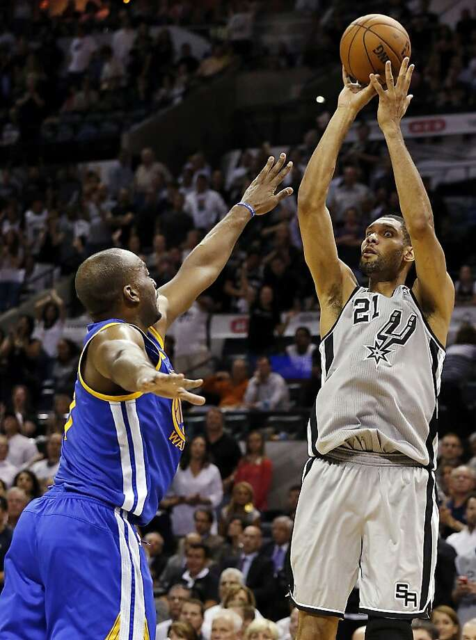 San Antonio Spurs' Tim Duncan shoots over Golden State Warriors' Carl Landry during second half action of Game 5 in the NBA Western Conference semifinals Tuesday May 14, 2013 at the AT&T Center. The Spurs won 109-91. Photo: Edward A. Ornelas, San Antonio Express-News