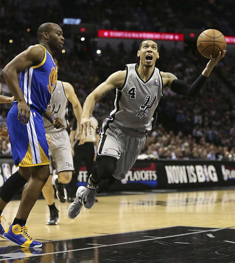San Antonio Spurs' Danny Green is fouled as he drive by Golden State Warriors' Carl Landry during the first half of Game 5 in the NBA Western Conference semifinals at the AT&T Center, Tuesday, May 14, 2013. Photo: Jerry Lara, San Antonio Express-News