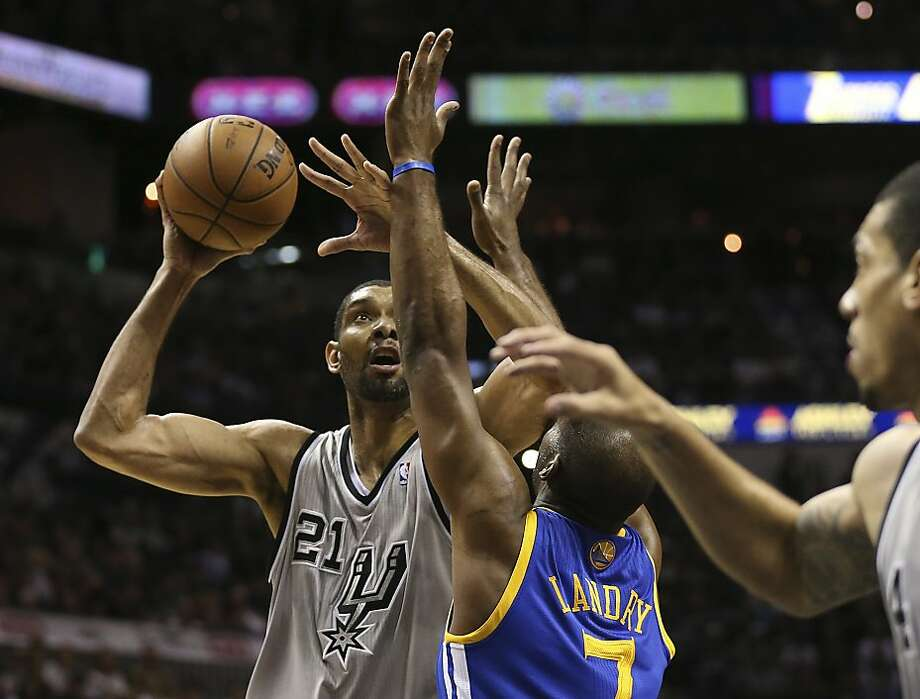 San Antonio Spurs' Tim Duncan scores over Golden State Warriors' Carl Landry during the first half of Game 5 in the NBA Western Conference semifinals at the AT&T Center, Tuesday, May 14, 2013. Photo: Jerry Lara, San Antonio Express-News