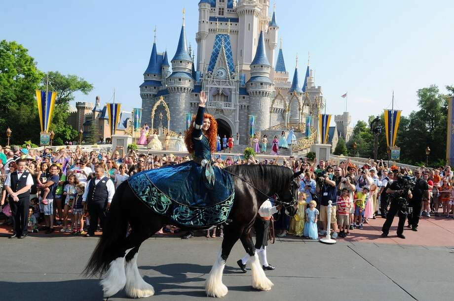 A model portraying Princess Merida rides into the celebration on her horse Angus at the Magic Kingdom at Walt Disney World Resort in conjunction with Mother's Day festivities on May 11, 2013 in Lake Buena Vista, Fla.