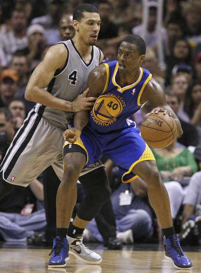 The  Spurs' Danny Green defends the Warriors' Harrison Barnes during second half action of Game 5 in the NBA Western Conference semifinals Tuesday May 14, 2013 at the AT&T Center. The Spurs won 109-91. Photo: Edward A. Ornelas, San Antonio Express-News