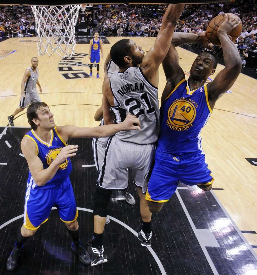 The  Spurs' Tim Duncan defends the Warriors' Harrison Barnes as Golden State Warriors' Andrew Bogut looks on during second half action of Game 5 in the NBA Western Conference semifinals Tuesday May 14, 2013 at the AT&T Center. The Spurs won 109-91. Photo: Edward A. Ornelas, San Antonio Express-News