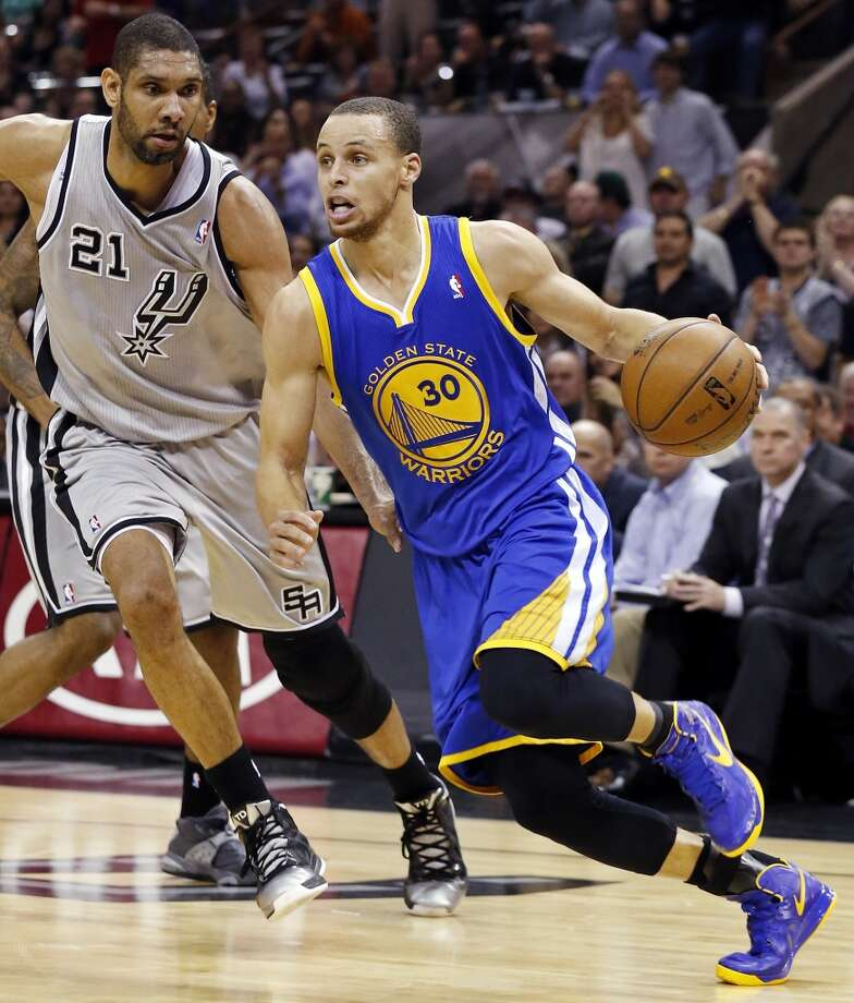The Warriors' Stephen Curry drives around the  Spurs' Tim Duncan during first half action of Game 5 in the NBA Western Conference semifinals Tuesday May 14, 2013 at the AT&T Center. Photo: Edward A. Ornelas, San Antonio Express-News