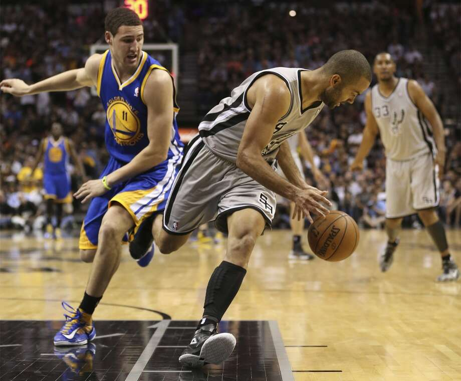 The Spurs' Tony Parker steals the ball from the Warriors' Klay Thompson during the second half of Game 5 in the NBA Western Conference semifinals at the AT&T Center, Tuesday, May 14, 2013. The Spurs won 109-91 and lead the series at 3-2. Photo: Jerry Lara, San Antonio Express-News