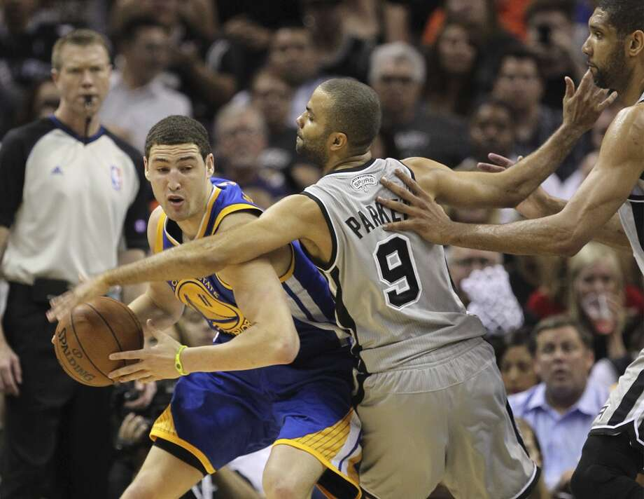 The Spurs' Tony Parker and Tim Duncan put pressure on the Warriors' Klay Thompson during the first half of Game 5 in the NBA Western Conference semifinals at the AT&T Center, Tuesday, May 14, 2013. Photo: Jerry Lara, San Antonio Express-News