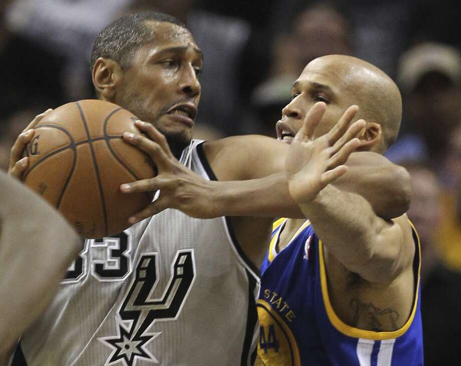 The Spurs' Boris Diaw tries to get through the Warriors' Richard Jefferson during the second half of Game 5 in the NBA Western Conference semifinals at the AT&T Center, Tuesday, May 14, 2013. The Spurs won 109-91 and lead the series at 3-2. Photo: Jerry Lara, San Antonio Express-News
