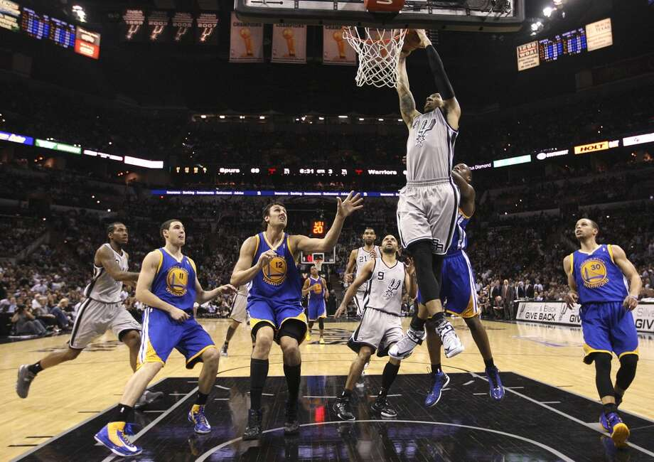 The Spurs' Danny Green scores during the second half of Game 5 in the NBA Western Conference semifinals against the Warriors at the AT&T Center, Tuesday, May 14, 2013. The Spurs won 109-91 and lead the series at 3-2. Photo: Jerry Lara, San Antonio Express-News
