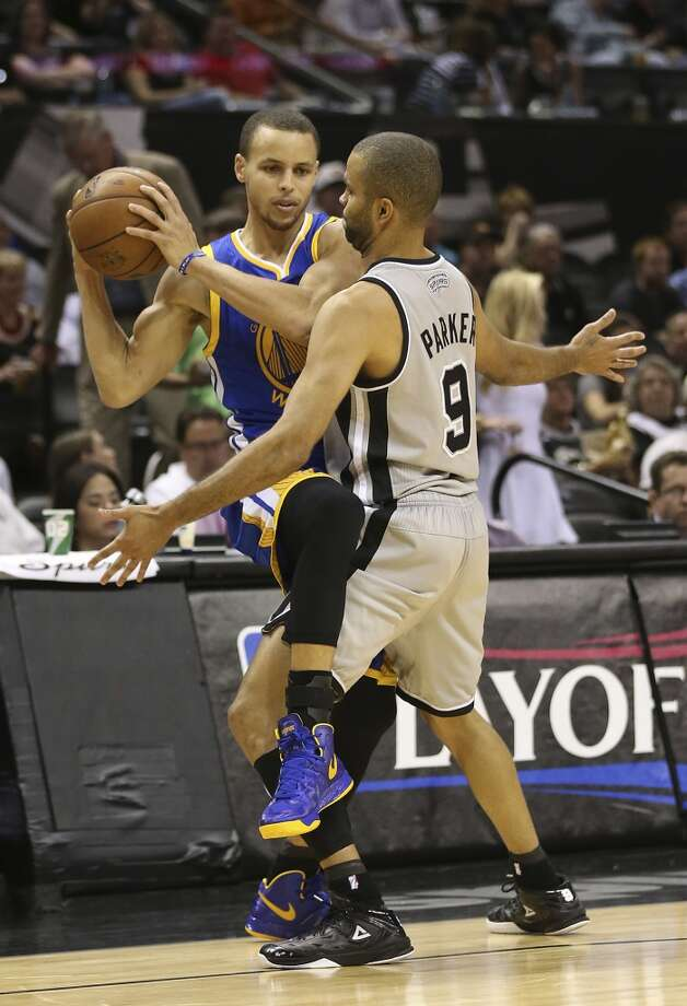 The Spurs' Tony Parker puts pressure on the  Warriors' Stephen Curry during the second half of Game 5 in the NBA Western Conference semifinals at the AT&T Center, Tuesday, May 14, 2013. The Spurs won 109-91 and lead the series at 3-2. Photo: Jerry Lara, San Antonio Express-News
