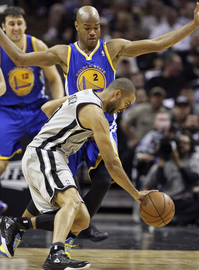 The Spurs' Tony Parker drives around the Warriors' Jarrett Jack during first half action of Game 5 in the NBA Western Conference semifinals Tuesday May 14, 2013 at the AT&T Center. Photo: Edward A. Ornelas, San Antonio Express-News